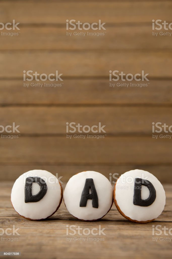 Cupcakes with text dad on arranged wooden plank stock photo