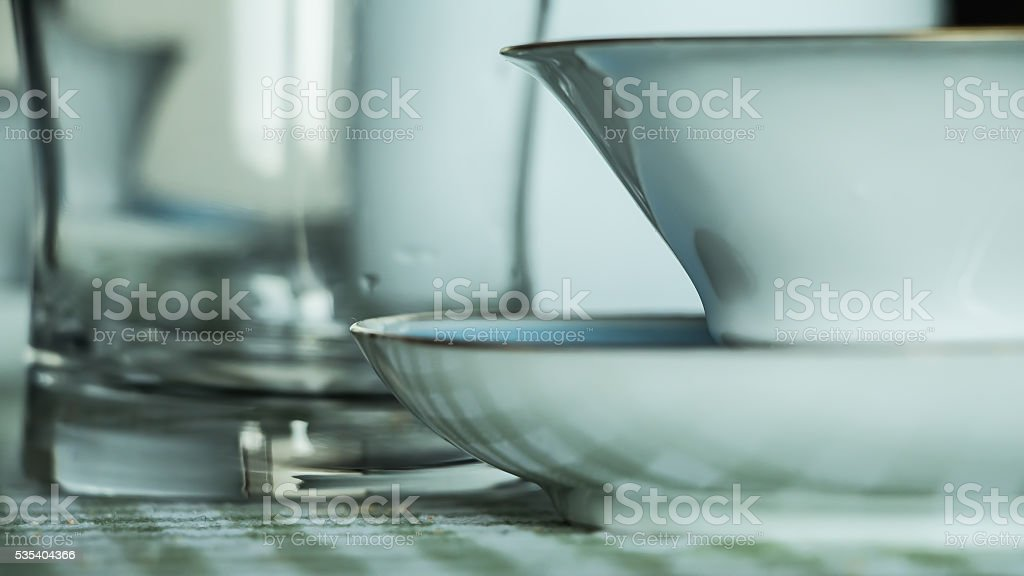 Cupful with glass on the table stock photo