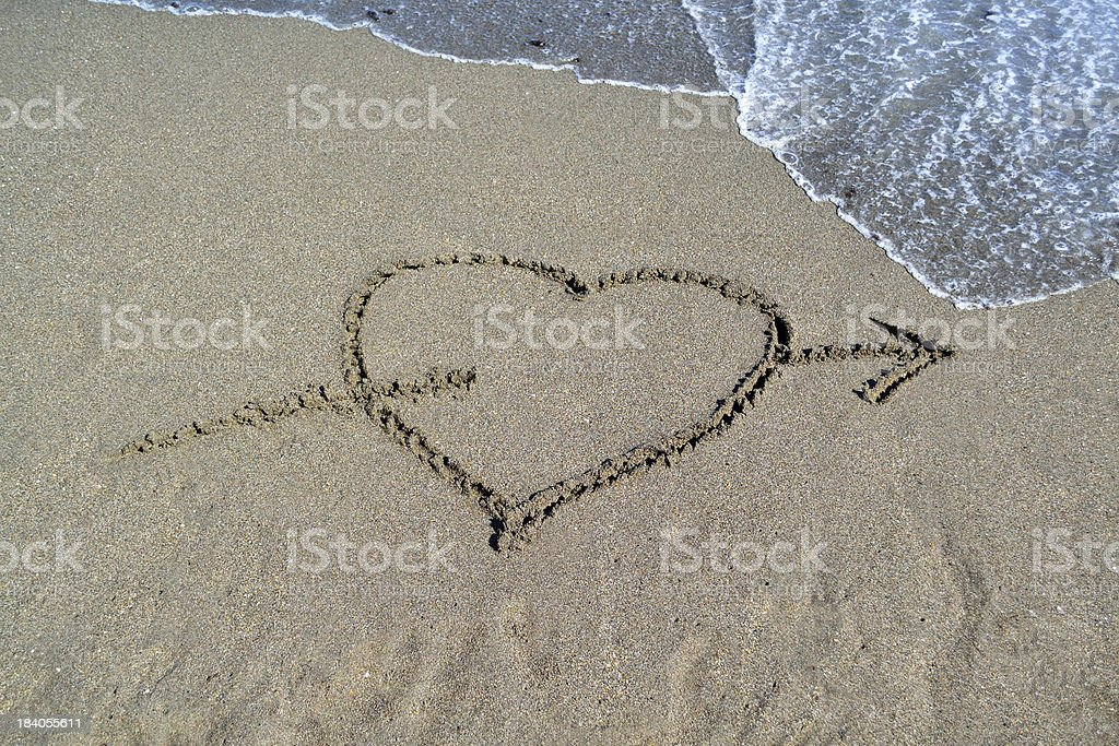 Cupid Heart in the Sand royalty-free stock photo