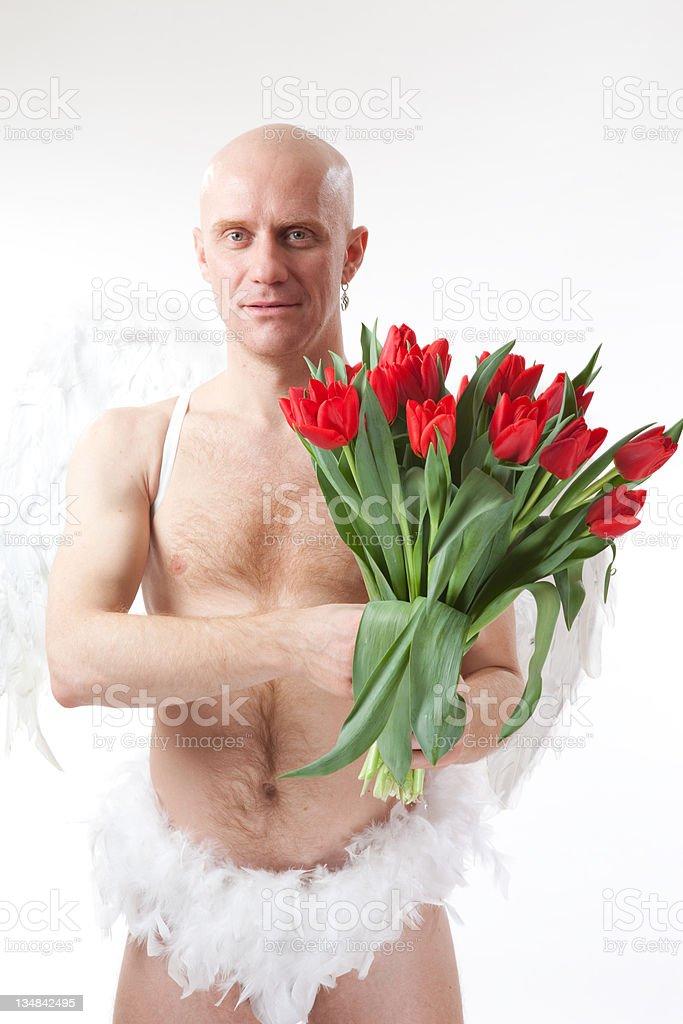 Cupid with tulip stock photo