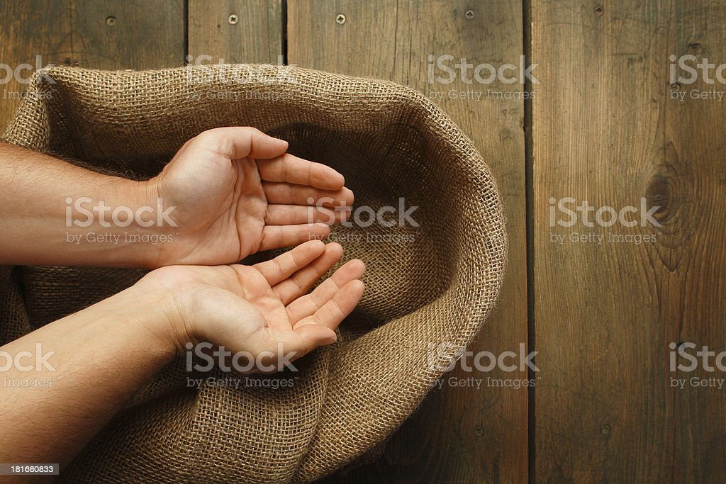 Cupped hands and sackcloth texture royalty-free stock photo
