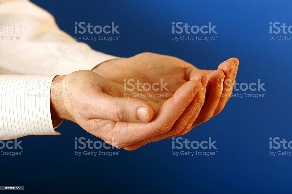 Cupped hands on blue royalty-free stock photo