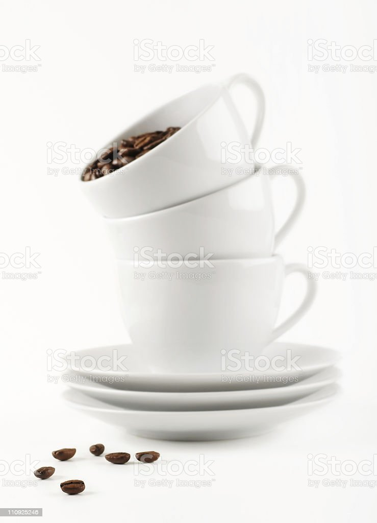 Cups and coffee beans royalty-free stock photo