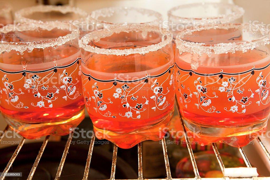 cups in fridger stock photo