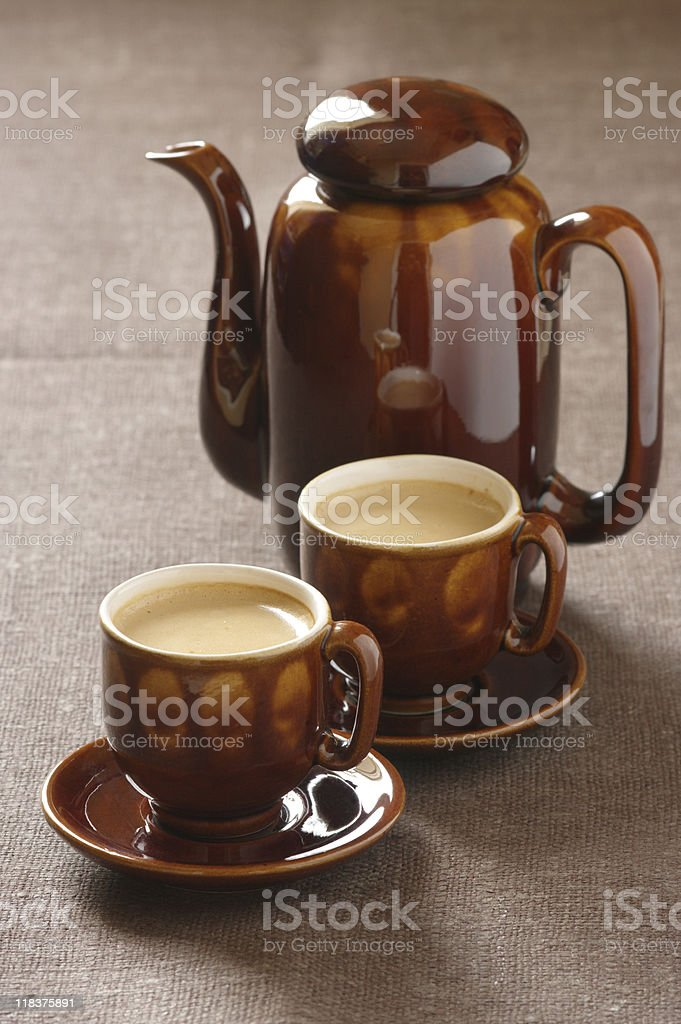 Cups of cappuccino and coffee pot royalty-free stock photo