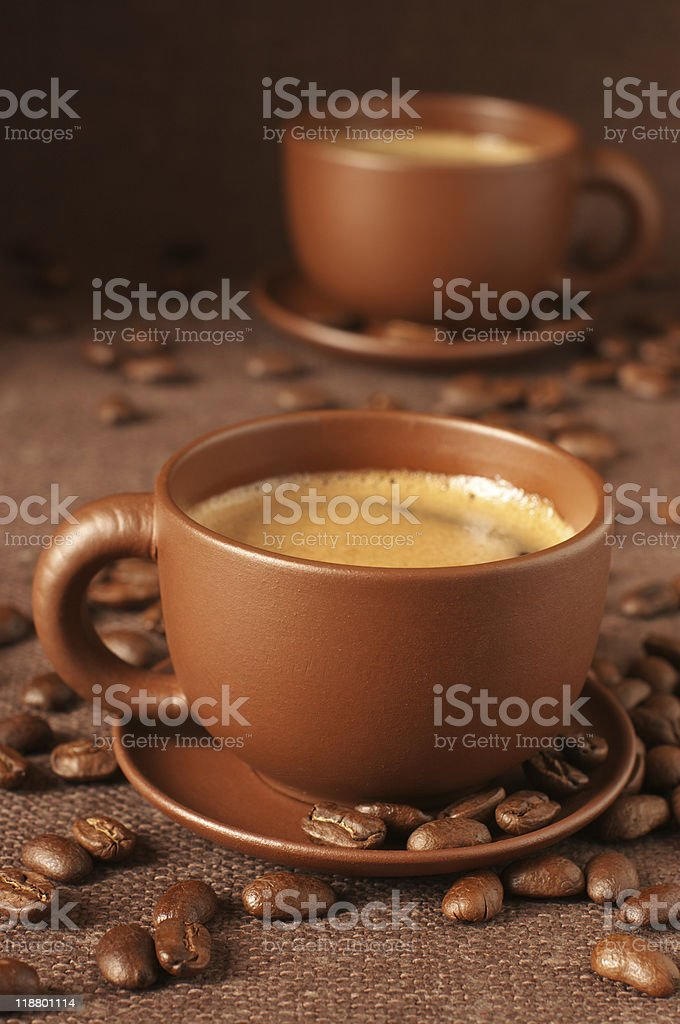 Cups of coffee and beans royalty-free stock photo