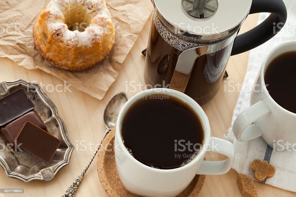 Cups of coffee and cake on tray stock photo