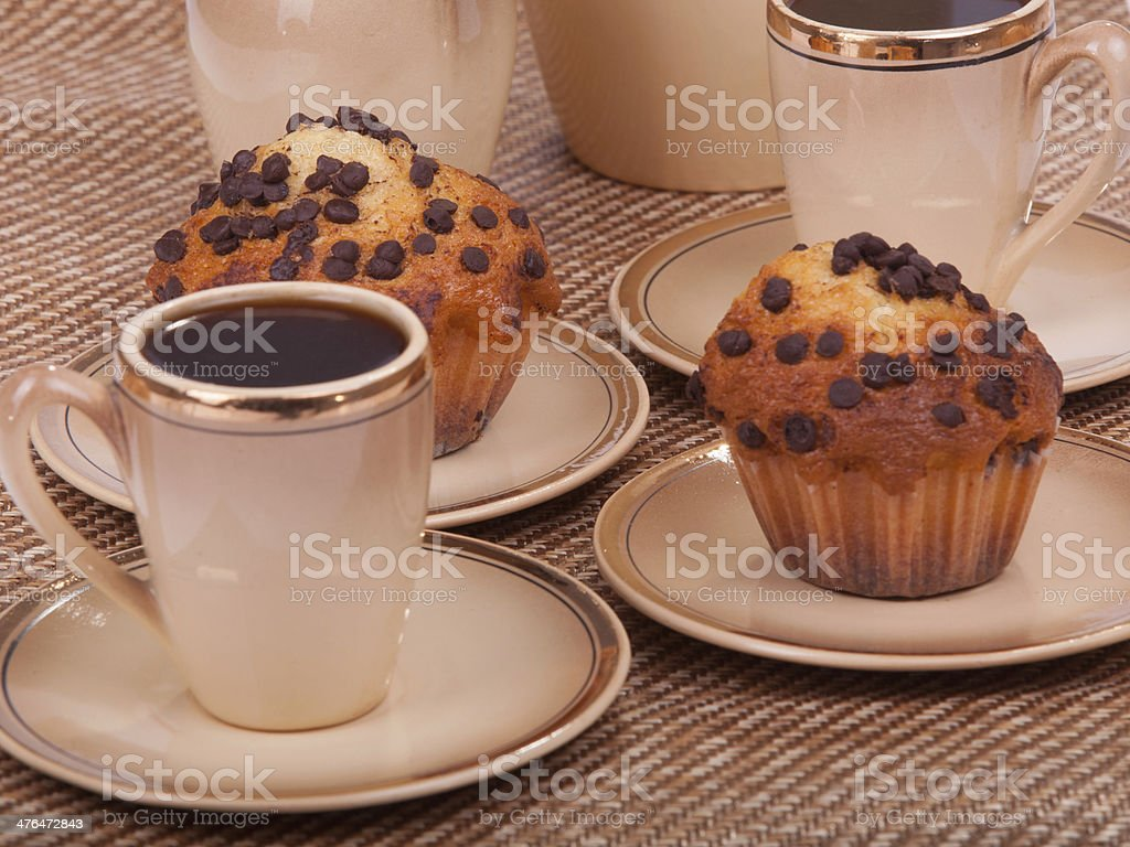 Cups of coffee and muffins royalty-free stock photo