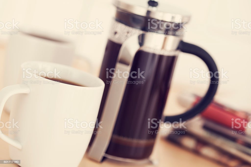 Cups of coffee and newspaper on table stock photo