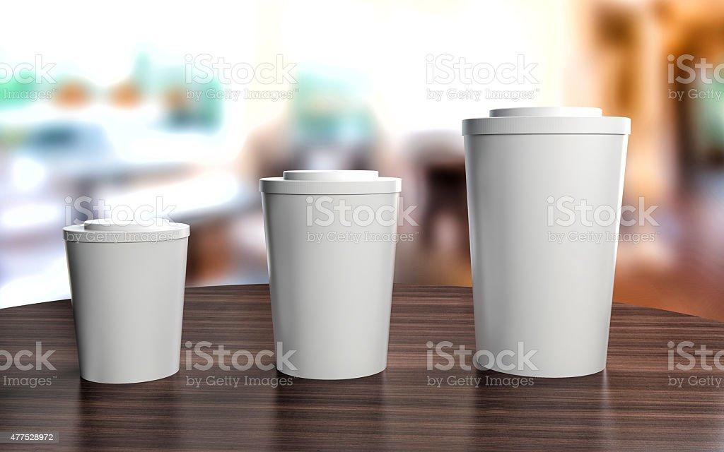 Cups of different sizes on cafe table stock photo