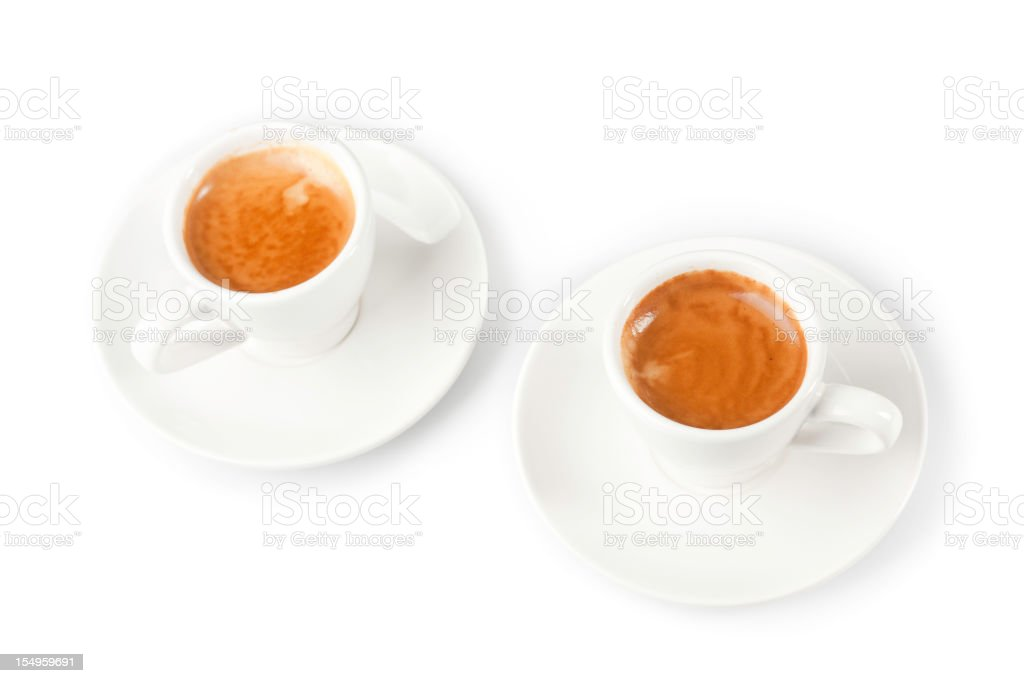 cups of espresso shot with crema and some coffee beans royalty-free stock photo