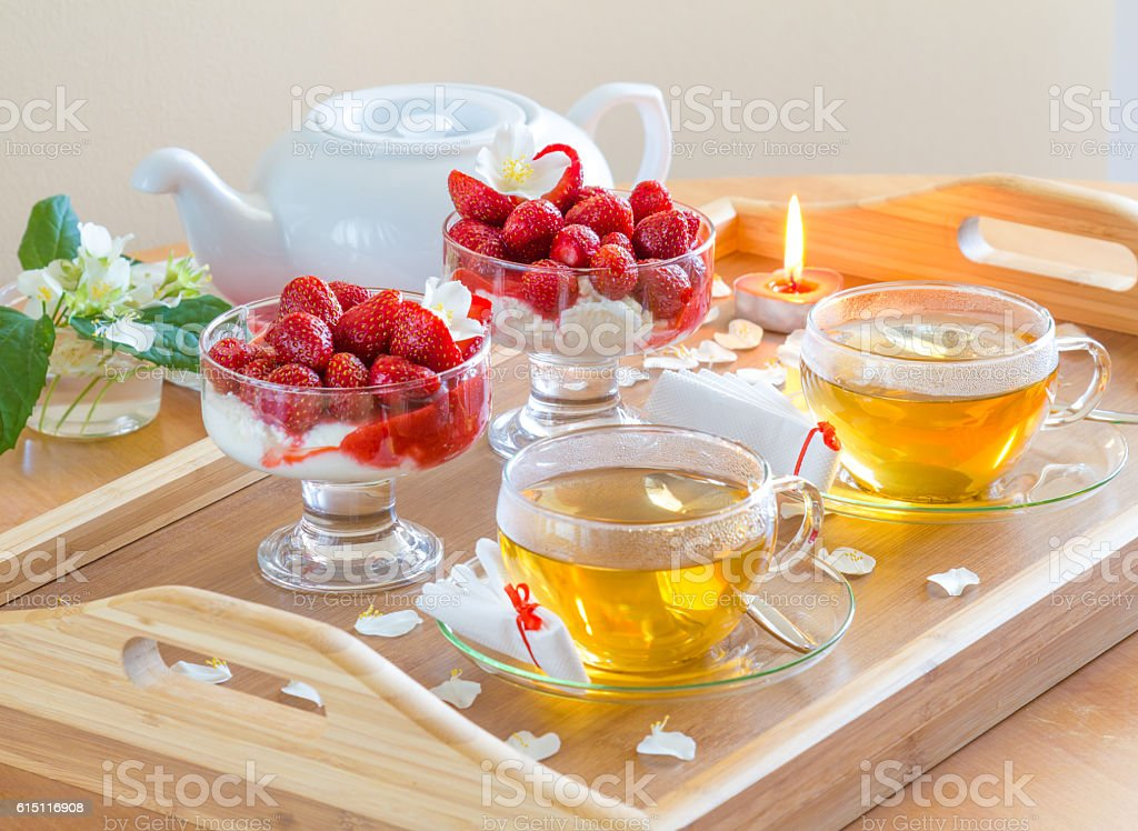 Cups of tea and linden flowers on wooden tray stock photo