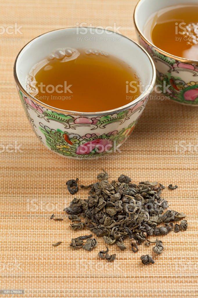 Cups with green gunpowder tea stock photo