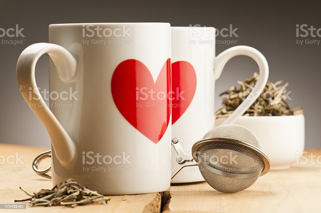 Cups with red hearts, loose leaf tea and difuser stock photo