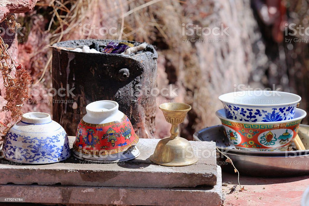 Cups-bowls-candlestick and improvised furnace. Drak Yerpa monastery-Tibet. 1515 stock photo