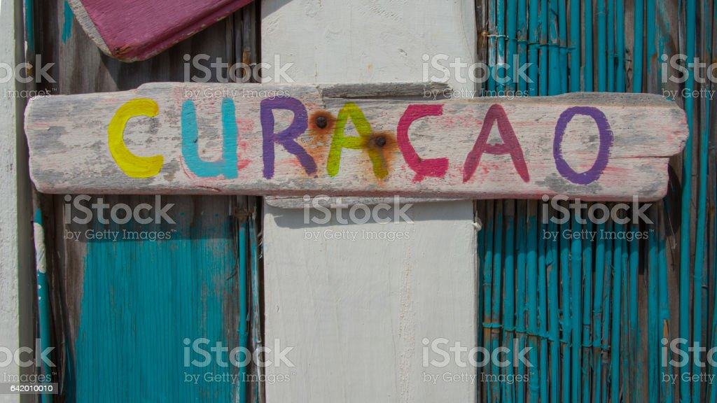 Curaçao sign on driftwood stock photo