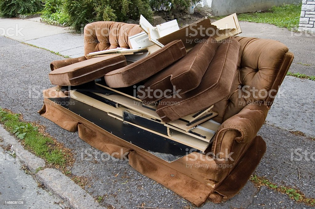 Curbside pickup for couch available for refurbishment stock photo