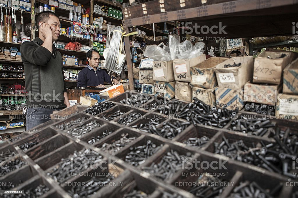 Curbside Streetview of a hardware store in China stock photo