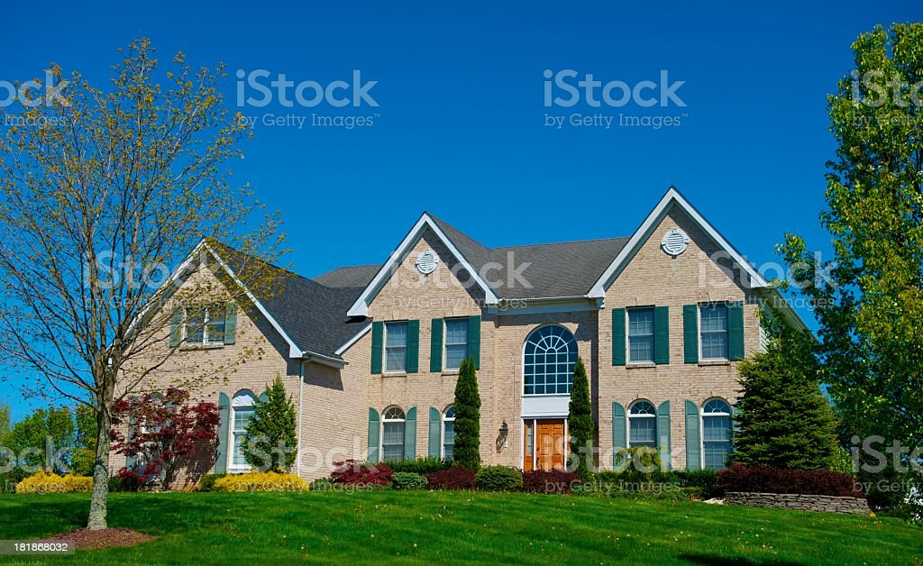 Curbside view of a large luxurious home stock photo