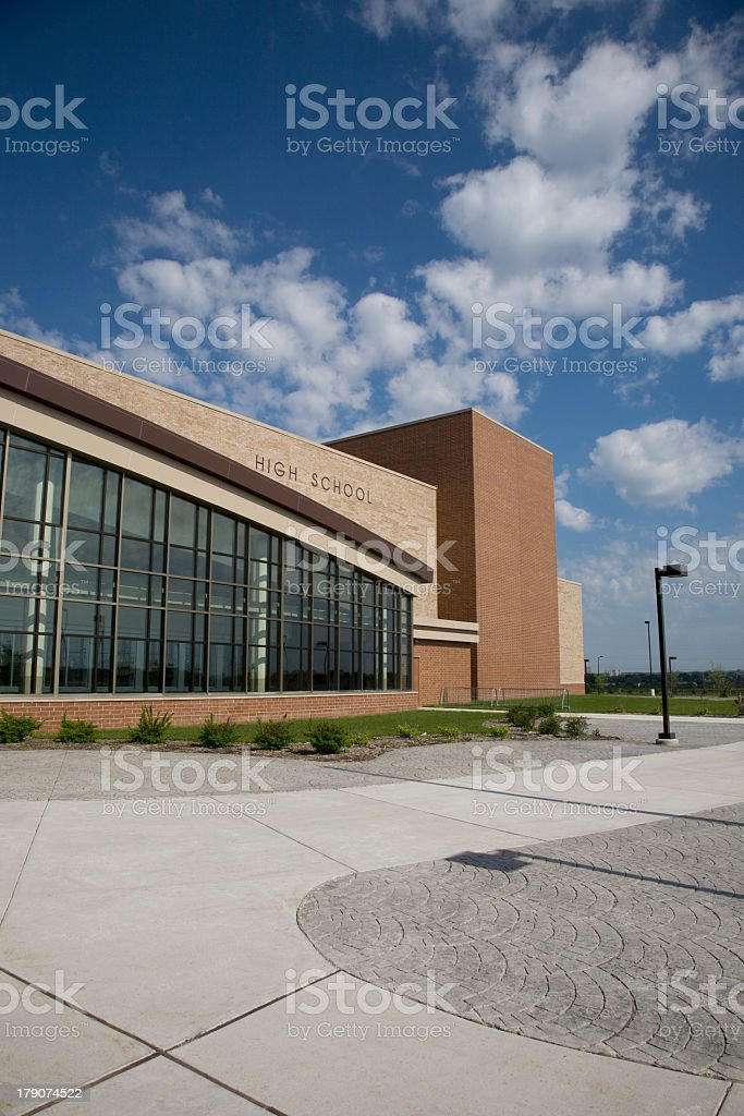 Curbside view of a modern high school royalty-free stock photo