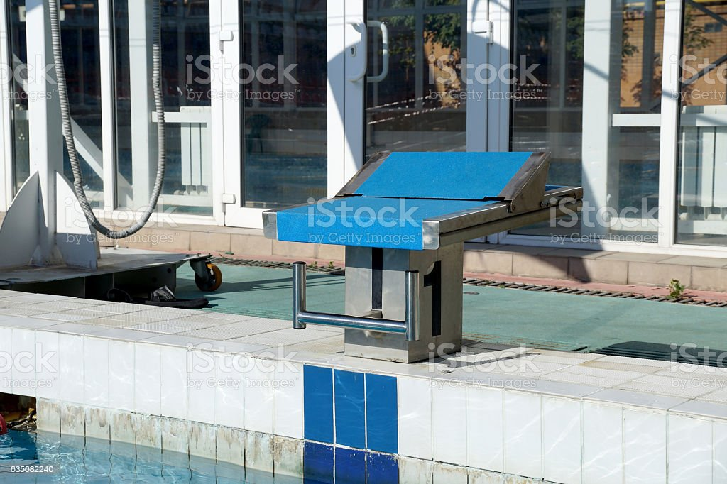 Curbstone for a jump to the pool stock photo