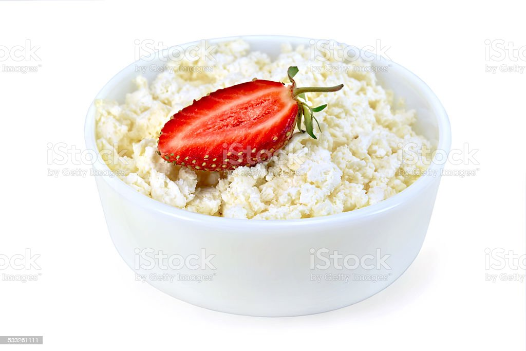 Curd in white bowl with strawberries stock photo