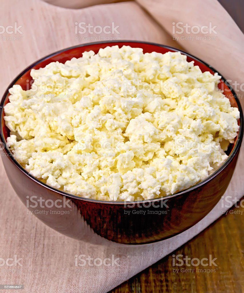 Curd in wooden bowl on board stock photo