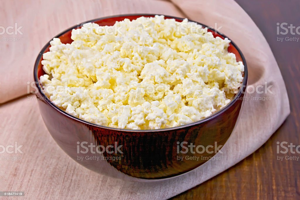 Curd in wooden bowl on board with cloth stock photo