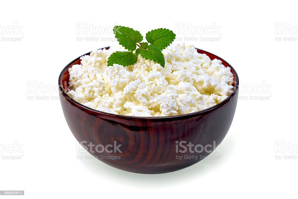Curd in wooden bowl with mint stock photo