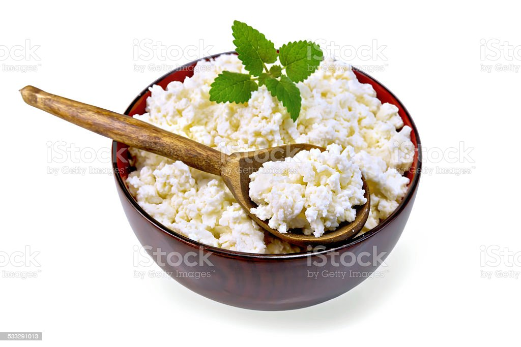 Curd in wooden bowl with spoon stock photo