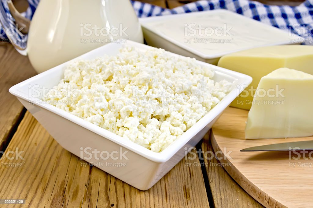 Curd with cheese and sour cream on board stock photo