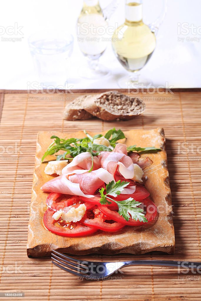 Cured ham, Parmesan and tomato royalty-free stock photo