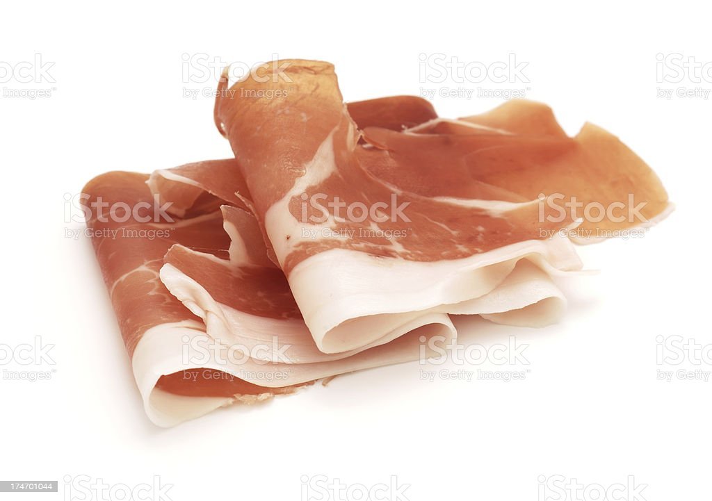 Cured Ham - Prosciutto isolated on white stock photo