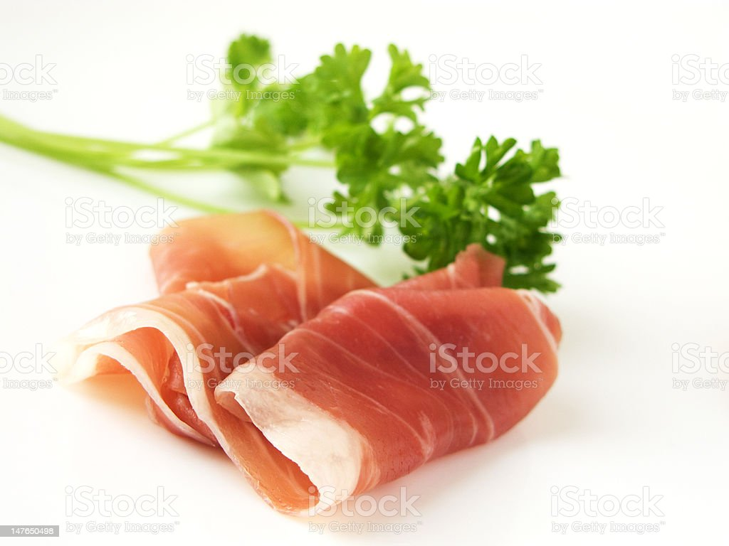 Cured Ham with parsley (Italian Prosciutto di Parma) stock photo