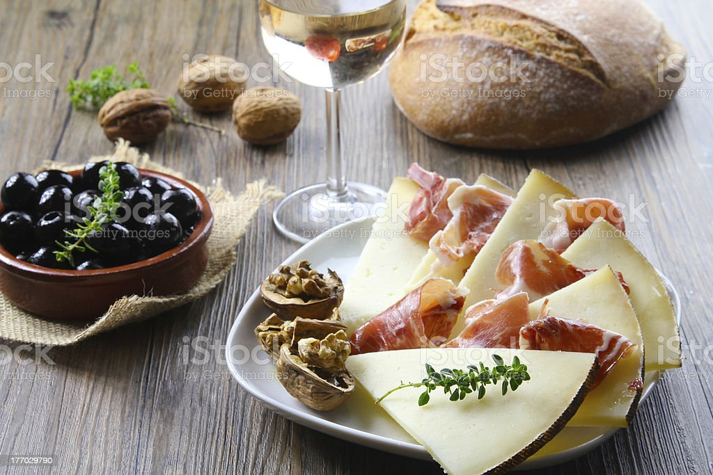 cured iberian ham and manchego cheese tapas stock photo