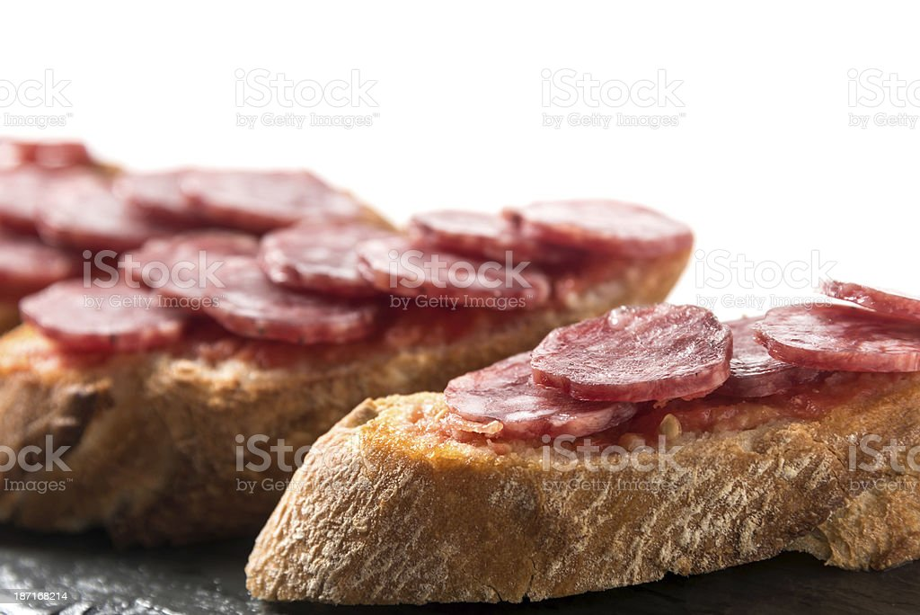 Cured salami (fuet) Canapes royalty-free stock photo