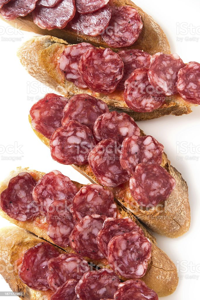 Cured salami (fuet) Canapes stock photo