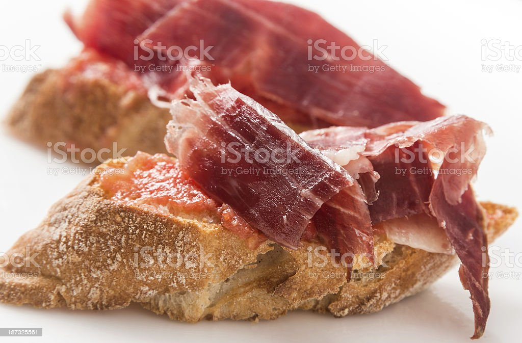 Cured Serrano ham canapes meat royalty-free stock photo