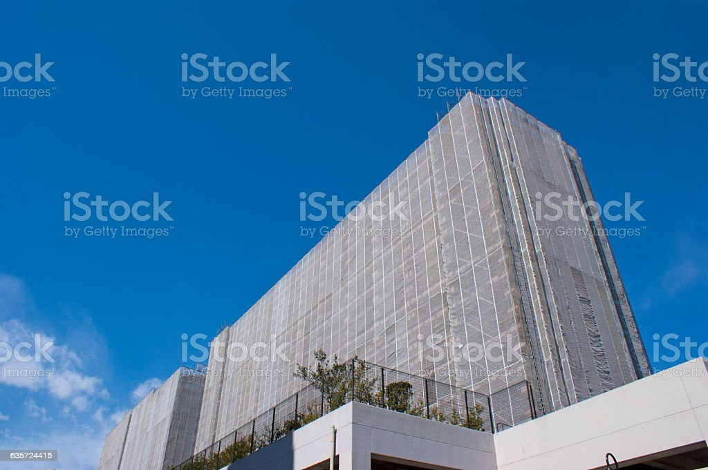 Curing seat and Scaffolding of an apartment during repair construction stock photo