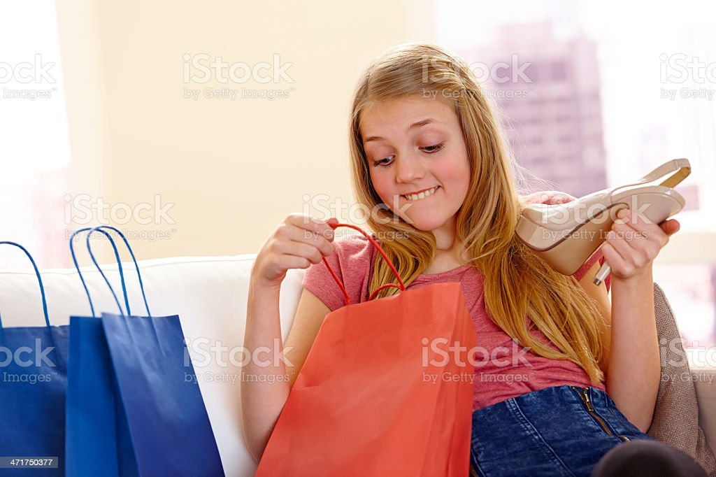 Curiosity little girl opening purchase after shopping royalty-free stock photo