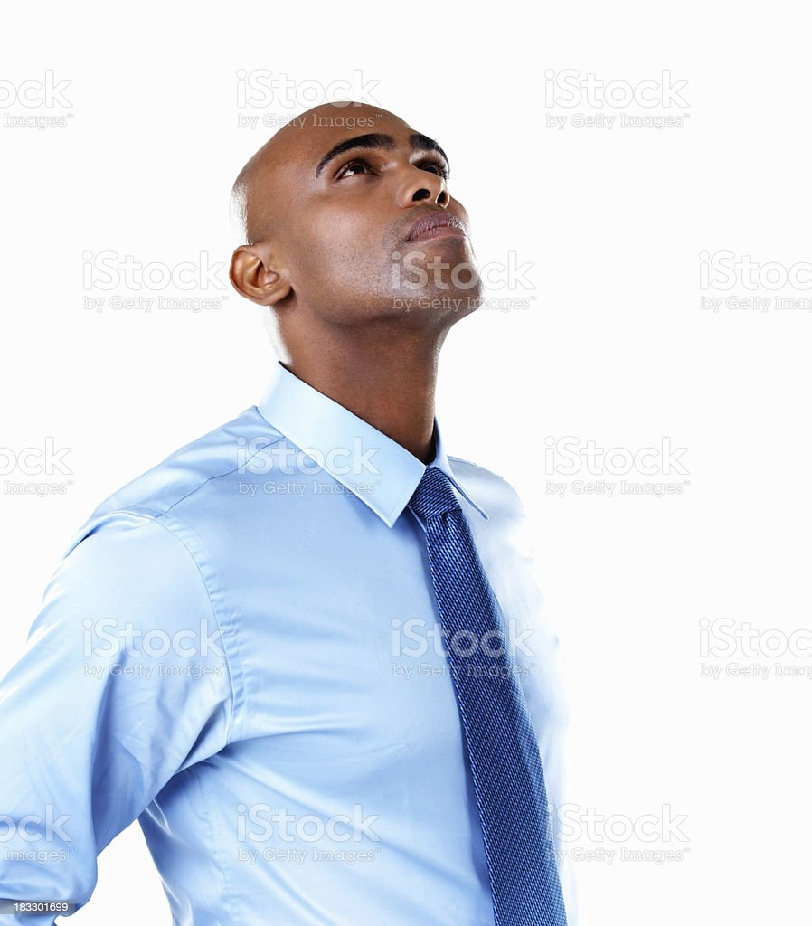 Curious African American business man against white background royalty-free stock photo