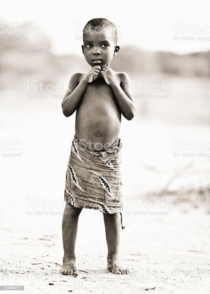 Curious African Child in the Desert stock photo