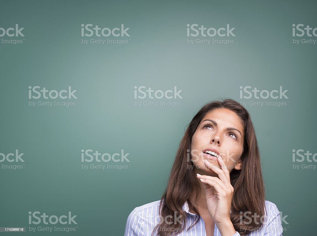 Curious beautiful Woman looking up into Copy Space royalty-free stock photo
