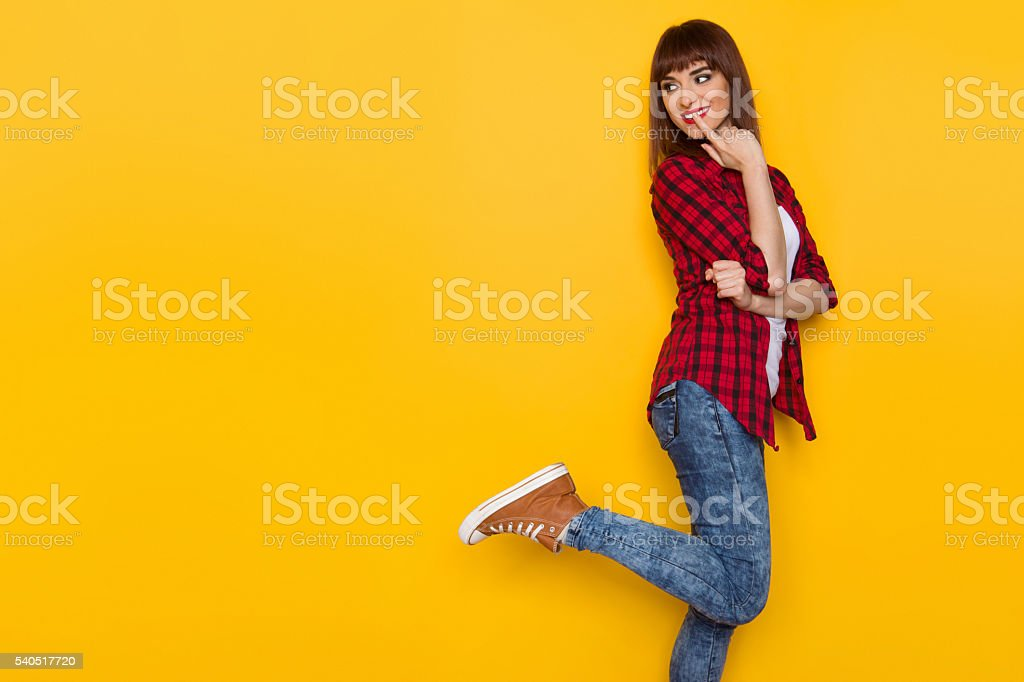 Curious Girl Looking Over Shoulder stock photo