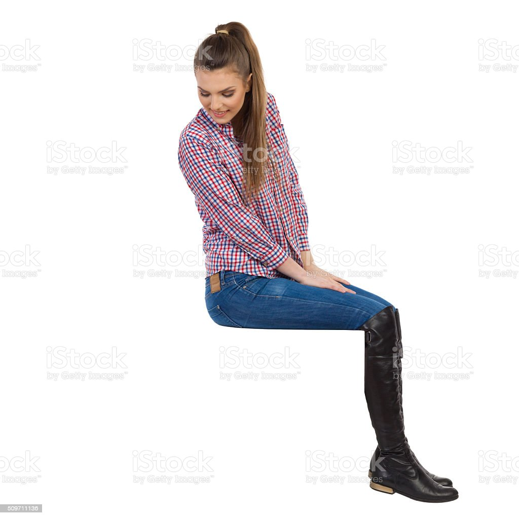 Curious Girl Sitting On Top And Looking Down stock photo