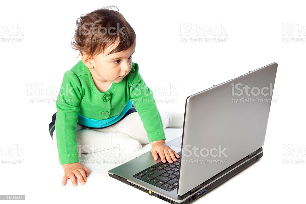 Curious little baby girl with laptop stock photo