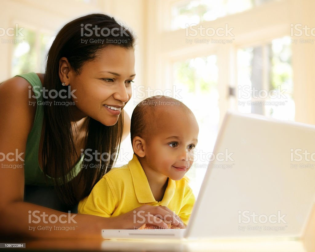 Curious Little Boy and Computer royalty-free stock photo