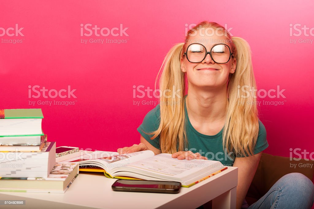 Curious, naughty, playful schoolgirl with hairstyle as Pippi Longstocking stock photo