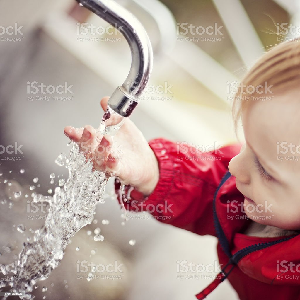 Curious thirsty child stock photo