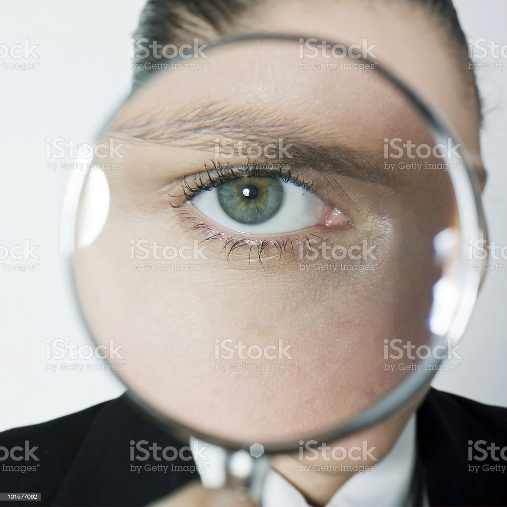 curious woman looking eyes through magnifying glass royalty-free stock photo